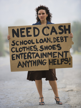 Young Woman Holding A Help-Needed Sign LANG_EVOIMAGES