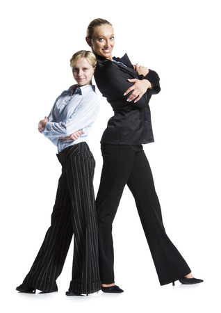 Two Businesswomen Standing Back To Back With Folded Arms