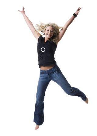 Portrait Of A Young Woman Jumping With Her Arms Raised