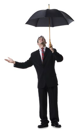 Businessman Holding An Umbrella And Looking Up LANG_EVOIMAGES