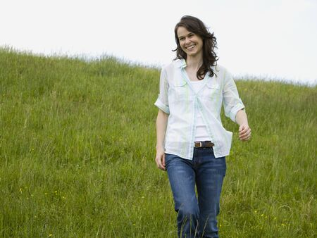 Low Angle View Of A Woman Laughing In A Field LANG_EVOIMAGES