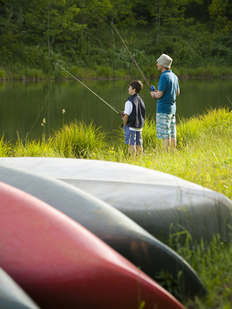 Profile Of A Man And His Son Fishing