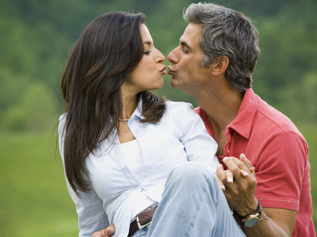 Close-Up Of A Man And A Woman Kissing Each Other