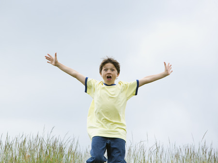 Portrait Of A Boy Running With His Arms Outstretched LANG_EVOIMAGES