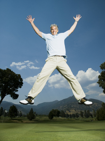 Portrait Of A Man Jumping With His Arms Raised