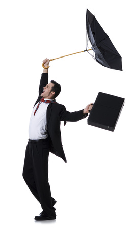 Profile Of A Businessman Holding An Umbrella And Jumping