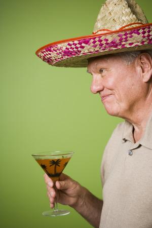 Portrait Of An Elderly Man Holding A Glass