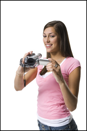 A Young Woman Filming With A Home Video Camera