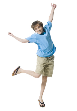 Portrait Of A Boy Jumping With Joy