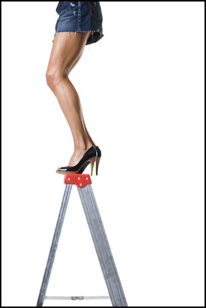 Low Section View Of A Young Woman Standing On A Step Ladder LANG_EVOIMAGES