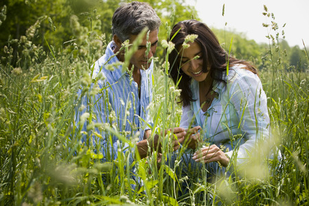 Man And A Woman Laughing In A Field