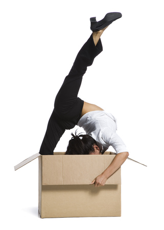 Female Contortionist Businesswoman Inside Cardboard Box LANG_EVOIMAGES
