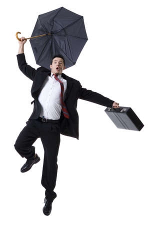 Portrait Of A Businessman Holding An Umbrella And Jumping LANG_EVOIMAGES