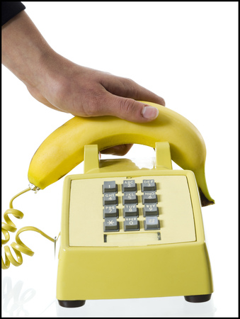 spectral colour: Close-Up Of A PersonS Hand Picking Up A Banana Telephone Receiver LANG_EVOIMAGES