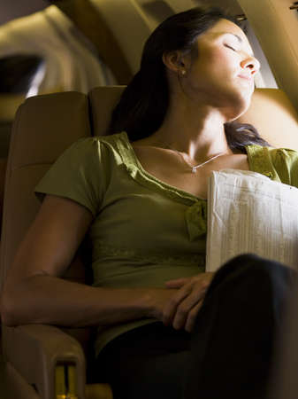 A Businesswoman Sleeping In An Airplane