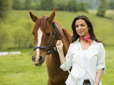 Portrait Of A Woman Holding The Reins Of A Horse LANG_EVOIMAGES