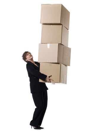 over burdened: Profile Of A Senior Woman Holding A Stack Of Cardboard Boxes