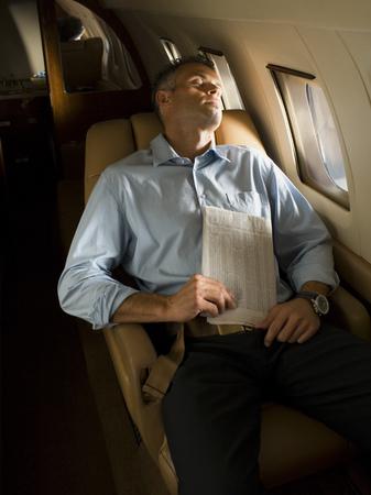 A Businessman Sleeping In An Airplane