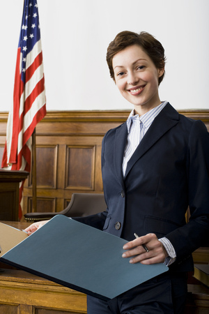 Portrait Of A Female Lawyer Standing In A Courtroom