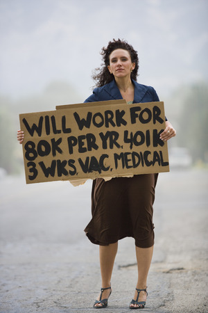 Young Woman Holding A Work-Wanted Sign