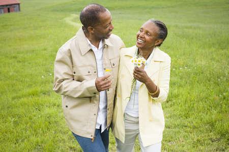 clothe: Close-Up Of A Senior Man And A Senior Woman Smiling