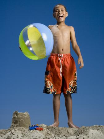 Portrait Of A Boy Holding A Beach Ball