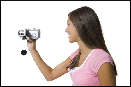 cut off saw: Profile Of A Young Woman Holding A Video Camera