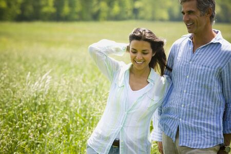ebullient: Close-Up Of A Man And A Woman In A Field LANG_EVOIMAGES