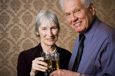 Portrait Of An Elderly Couple Holding Glasses Of Wine