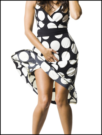 embarrassment: WomanS Polka Dot Dress Blowing In Breeze LANG_EVOIMAGES
