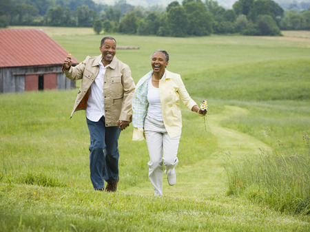 ebullient: Senior Woman And A Senior Man Running In A Field