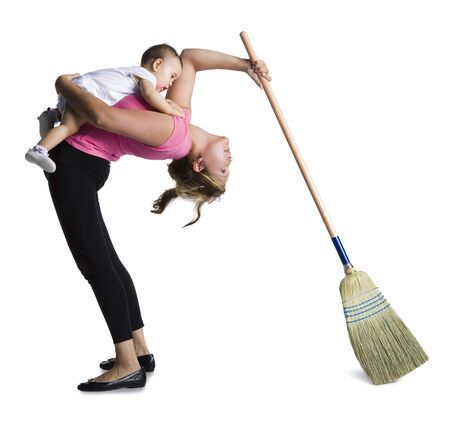 Contortionist Mother Sweeping While Holding Baby Daughter LANG_EVOIMAGES