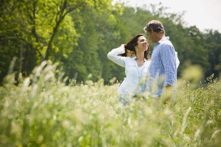 Profile Of A Man And A Woman Nuzzling In A Field