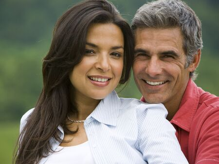 Close-Up Of A Man And A Woman Smiling