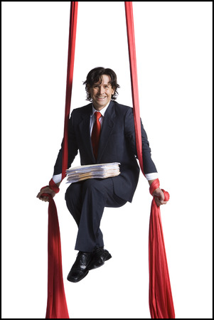 Businessman Tangled In Red Drapes