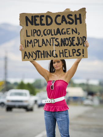 Woman Standing On Side Of Road Soliciting Cash
