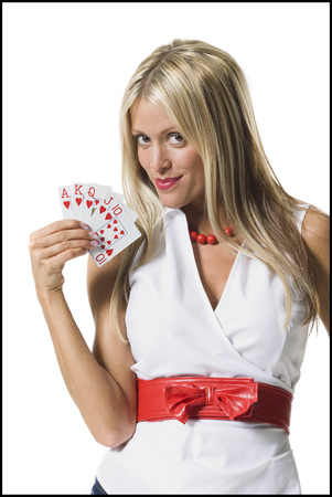 Portrait Of A Young Woman Showing Playing Cards And Smiling
