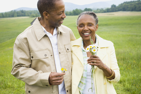 clothe: Portrait Of A Senior Man And A Senior Woman Smiling
