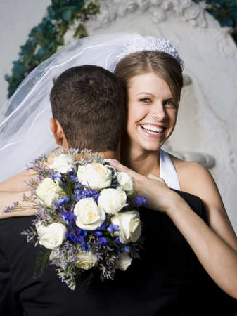 Portrait Of A Newlywed Couple Embracing