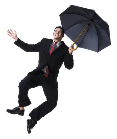 Businessman Holding An Umbrella And Jumping