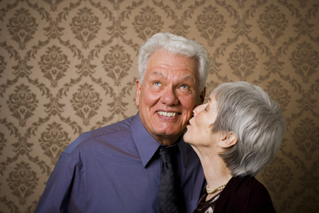 Close-Up Of An Elderly Woman Kissing An Elderly Man