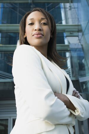 Portrait Of A Young Businesswoman Standing In Front Of A Building