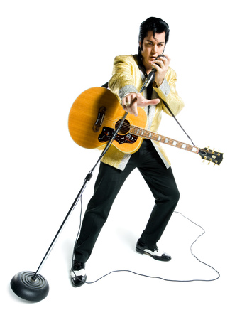 Portrait Of An Elvis Impersonator Singing Into A Microphone