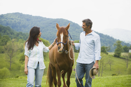Man And A Woman With A Horse LANG_EVOIMAGES