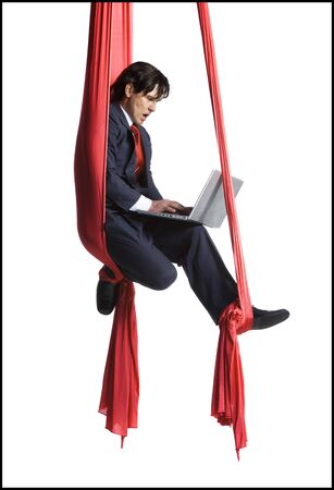 intertwined: Businessman Tangled In Red Drapes