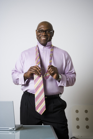 Portrait Of A Businessman Tying His Tie