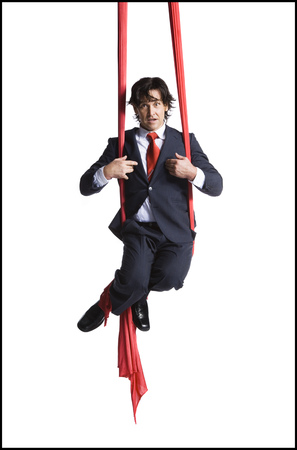 trapped: Businessman Tangled In Red Drapes