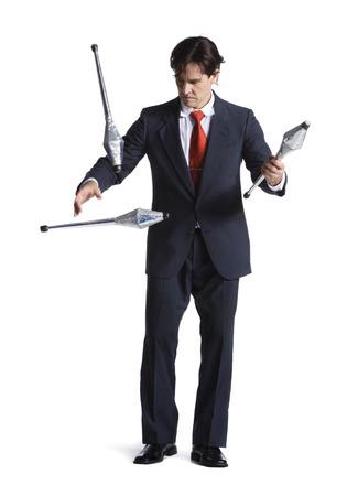 multi tasking: Businessman Juggling Pins