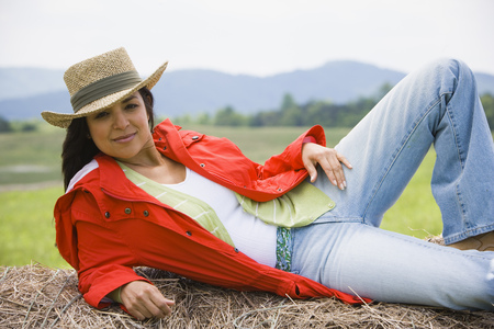 Portrait Of A Woman Lying On A Hay Bale
