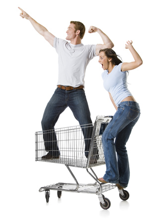 Woman Pushing Shopping Cart With Boyfriend Inside LANG_EVOIMAGES